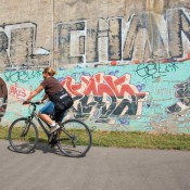 Graffiti provides an art background in the Dequindre Cut, a rail line turned multiuse trail in Detroit. Source: Livedetroit.com