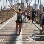 Pedestrians cross the Brooklyn Bridge. (AP Photo/Kathy Willens)