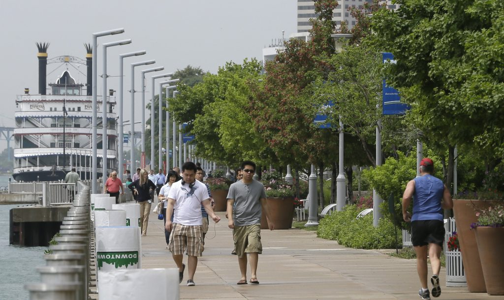 Walkers and joggers along the Detroit RiverWalk (AP Photo / Carlos Osorio)