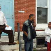 Todd Marcus (left) and Elder C.W. Harris in front of Martha's Place, a recovery program for women in Sandtown (Photo by Jen Kinney)