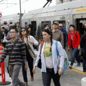 Pedestrians disembark from a train at Union Station in Los Angeles. (AP Photo/Nick Ut)
