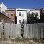 Tenants were forced to leave these homes, owned by the District of Columbia Housing Authority, in 2013, before the agency renovated them and sold them to wealthy buyers. (AP Photo/Alex Brandon)