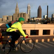 A bicyclist commutes on the Lorain-Carnegie Bridge in Cleveland, OH (Marvin Fong / he Plain Dealer