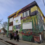 Officials at the Michigan Urban Farming Initiative unveiled a partnership  that will help transform this long-vacant apartment building into a community center and cafe to anchor its growing agricultural campus (Todd McInturf / The Detroit News)