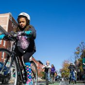 "Cyclists take an inaugural spin on Baltimore's new protected ""cycle track."" (Brian O'Doherty)"