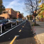 The new Maryland Avenue cycle track in Baltimore, part of the city's emerging network of protected lanes (Bikemore)