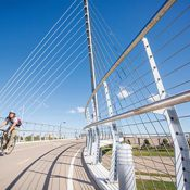 The Sabo Bridge, shown here, is one of 28 connection points along the Midtown Greenway, a well-developed pedestrian and bicycling network in Minneapolis. (Philip Hussong / Hennepin County)