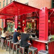 A repurposed shipping container serves as an outdoor bar at Cinquecento restaurant in Boston. (John Tlumacki / The Boston Globe)